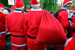 UK ENGLAND LONDON 16DEC06 - Detail view of revellers dressed as Santa Claus with a sack filled with goodies as they gather at Camden Lock for the annual Santacon outing. Every December for the last 13 years, Cacophonous Santas have been visiting cities around the world, engaging in a bit of Santarchy as part of the annual Santacon events. . . It all started back in 1994 when several dozen Cheap Suit Santas paid a visit to downtown San Francisco for a night of Kringle Kaos. Things have reached Critical Xmas and Santarchy is now a global phenomenon.. . jre/Photo by Jiri Rezac. . © Jiri Rezac 2006. . Contact: +44 (0) 7050 110 417. Mobile:  +44 (0) 7801 337 683. Office:  +44 (0) 20 8968 9635. . Email:   jiri@jirirezac.com. Web:    www.jirirezac.com. . © All images Jiri Rezac 2006 - All rights reserved.