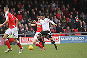 Massimo Luongo pushes forward closely watched by Crewe Captain Harry Davis during the Sky Bet League 1 match between Crewe Alexandra and Swindon Town at Alexandra Stadium, Crewe, England on 28 February 2015. Photo by Andrew Morfett.