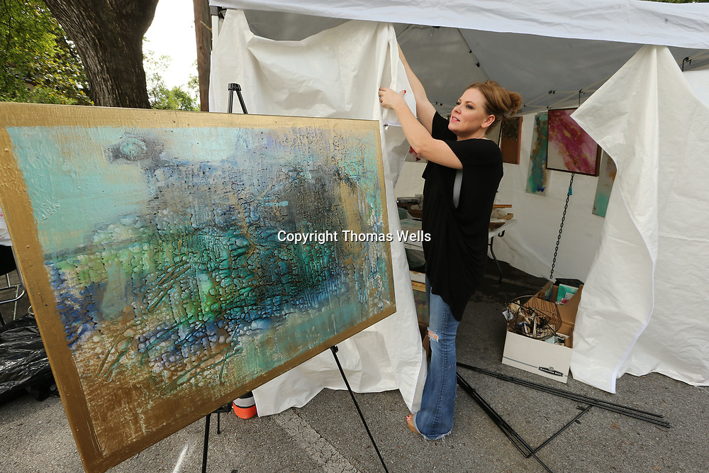Elizabeth Behm of Ripley and other artists spend Friday afternoon unvieling their booths and begin getting ready for Saturday opening of the annual Gumtree Festival.
