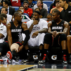 Oct 23, 2013; New Orleans, LA, USA; Miami Heat shooting guard Dwyane Wade (3) and small forward LeBron James (6) and power forward Chris Bosh (1) and shooting guard Ray Allen (34) on the bench during the fourth quarter of a preseason game at New Orleans Arena. The Heat defeated the Pelicans 108-95. Mandatory Credit: Derick E. Hingle-USA TODAY Sports