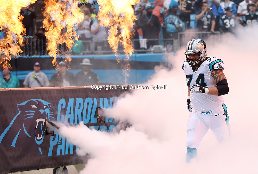 Carolina Panthers tackle Mike Remmers (74) comes onto the field in a cloud of white smoke with fire blasting in the background during pregame player introductions before the 2015 NFL week 3 regular season football game against the New Orleans Saints on Sunday, Sept. 27, 2015 in Charlotte, N.C. The Panthers won the game 27-22. (©Paul Anthony Spinelli)