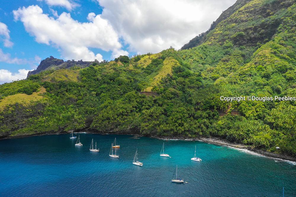 Cruising Yachts anchored, Hapatoni, Tahuata, Marquesas; French Polynesia; South Pacific