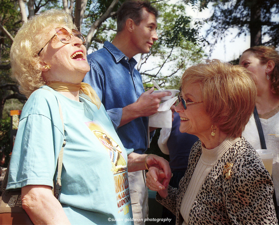 Golden Girls Betty White, left, and Estelle Getty share a laugh during the 4th annual fundraising event for the Wildlife Waystation at the Brentwood area home of Los Angeles Mayor Richard Riordan. The Wildlife Waystation, based in the Angeles National Forest, provides shelter and care for animals, reptiles and birds undergoing rehabilitation and problem-solving care. Photo/Wildlife Waystation, Susan Goldman.