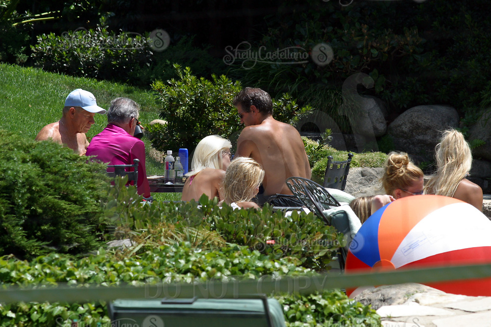 Jul 21, 2002; Holmby Hills, California, USA; HUGH HEFNER wears a hot pink satin robe while playing Batgammon for cash with his personal doctor MARK SAGINOR and friend during Fun in the Sun-day @ the Playboy Mansion. Playmates and girlfriends sun bathe next to the grotto.