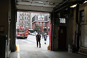 26 February 2013. Bronx, New York. Engine Co. 73/Hook & Ladder 42 at 655-659 and 661 Prospect Ave., the Bronx. From left to right, firemen Thomas Herrick, Bill Schauffer and Lieutenant Richard Nash return from an emergency call by a man who said he was experiencing severe chest pains. The firefighters left after EMS workers arrived on the scene. 2/26/13. Photograph by Nathan Place/CUNY Journalism Photo