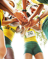 At the starting line of the Metro Conference Championships Oak Ridge High School girls cross country team form a circle before the race that was held at Dubsdread Country Club, Orlando, Wednesday, October 19, 2005. Coach Bill Stamper hopes of becoming one of the first predominately African-American teams to win the state cross country championship. (Roberto Gonzalez/Orlando Sentinel)