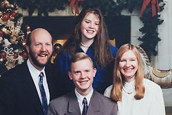 John and Hilary with their two children XXXX and XXX 1n1993. <br /> John and Hilary Bond who met in Majorca at Club 18-30 in May 1973 where John was a Rep and Hilary a guest. This year the couple have just celebrated their 44th wedding anniversary. Watford, Herts, May 29 2018.