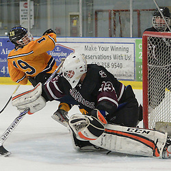 Staff photos by Tom Kelly IV<br /> Garnet Valley goalie G Schenk (73) makes a save on a shot from Springfield's Nick Farese (19) during the Springfield, Garnet Valley hockey game on Friday night February 6, 2015 at Ice Works.