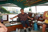 Tanka Fisherwoman in Sampan, Aberdeen Fishing Village, Hong Kong, Hong Kong, August 2008   Photo: Peter Llewellyn