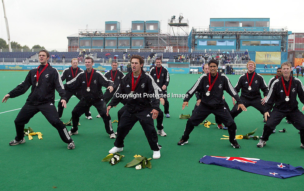04 August 2002, Belle Vue Hockey Complex, Men's Hockey  Final - New Zealand v Australia, Commonwealth Games, Manchester, England. The New Zealand men perform a haka to the crowd after receiveing their silver medals today. Australia won the match 5-1. Pic: Andrew Cornaga/Photosport