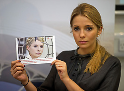 © London News Pictures. 05/11/2012. London, UK.  EUGENIA TYMOSHENKO, daughter of former Ukrainian prime minister Yulia Tymoshenko holding a picture of her mother Yulia Tymoshenko following a press conference in London on November 05, 2012 about the imprisonment of her mother. A Ukrainian court sentenced Yulia Tymoshenko to seven years in prison after she was found guilty of abuse of office. Photo credit: Ben Cawthra/LNP.