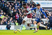 Kortney Hause (Aston Villa) & Aaron Connolly (Brighton) during the Premier League match between Brighton and Hove Albion and Aston Villa at the American Express Community Stadium, Brighton and Hove, England on 18 January 2020.