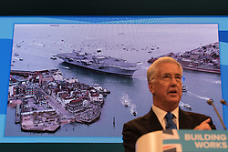 © Licensed to London News Pictures  . 03/10/2017 . Manchester , UK . Defence Secretary MICHAEL FALLON delivers his keynote speech , on day three of the Conservative Party Conference at the Manchester Central Convention Centre . Photo credit : Joel Goodman/LNP