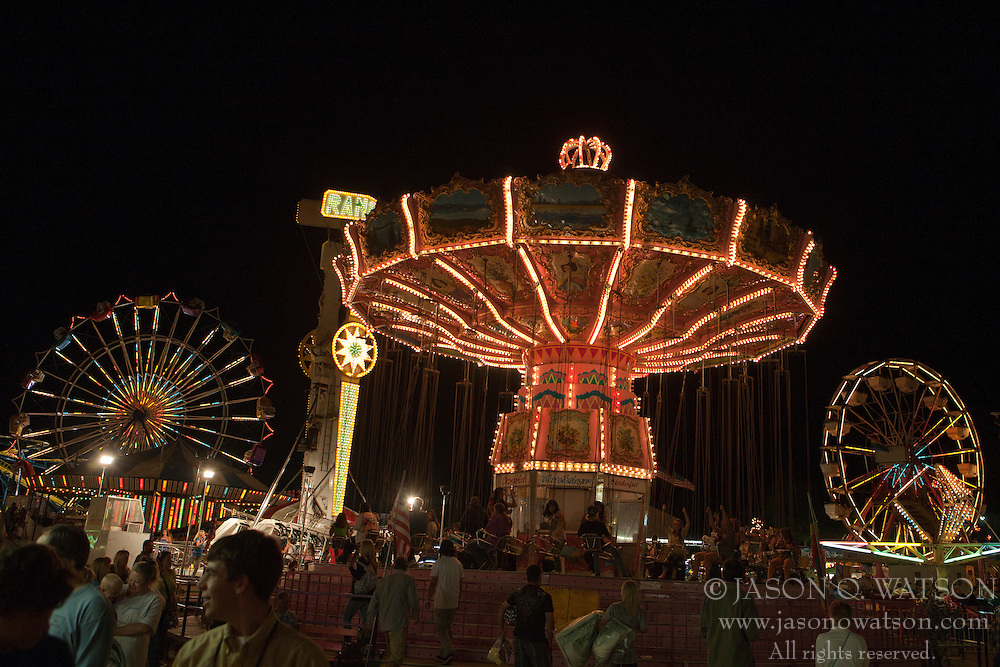 Farris wheels and illuminated rides at night, California Mid-State Fair, Paso Robles, California, United States of America