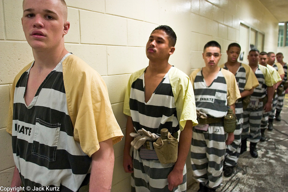 "24 MARCH 2004 - PHOENIX, AZ, USA: Juveniles sentenced as adults and serving on the jail chain line up in the Maricopa County Jail in Phoenix, AZ, before going out to work on city streets March 24, 2004. The juveniles volunteer to serve Maricpoa County Sheriff Joe Arpaio's chain gang. The sheriff, who claims to be ""the toughest sheriff in America,"" has chain gangs in both the men's and women's jails and now has a chain gang for juveniles sentenced and serving time as adults in the county jail system. The sheriff claims it is the only juvenile chain gang in the country.   PHOTO BY JACK KURTZ"