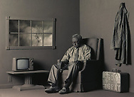 For the lead photo, actor Chuck McGraw sat motionless in a room of gray built in the Free Press' basement.  Furnishings were vintage Salvation Army and a gallon of gray latex paint added the finishing tough. THE IMAGE TOOK FIRST PLACE IN THE ISSUE ILLUSTRATION CATAGORY IN THE RECENT PICTURES OF THE YEAR COMPETITION AT THE UNIVERSITY OF MISSOURI.