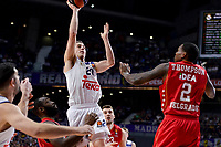 Real Madrid's Jaycee Carroll and Crvena Zvezda Mts Belgrade's Deon Thompson during Turkish Airlines Euroleague match between Real Madrid and Crvena Zvezda Mts Belgrade at Wizink Center in Madrid, Spain. March 10, 2017. (ALTERPHOTOS/BorjaB.Hojas)