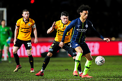 Leroy Sane of Manchester City is challenged by Regan Poole of Newport County  Mandatory by-line: Ryan Hiscott/JMP - 16/02/2019 - FOOTBALL - Rodney Parade - Newport, Wales - Newport County v Manchester City - Emirates FA Cup fifth round proper