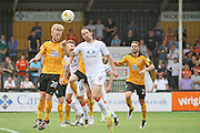 Cambridge Utd defender Max Clark (20) clears in from of Luton Town forward Danny Hylton (9) during the EFL Sky Bet League 2 match between Cambridge United and Luton Town at the R Costings Abbey Stadium, Cambridge, England on 27 August 2016. Photo by Nigel Cole.