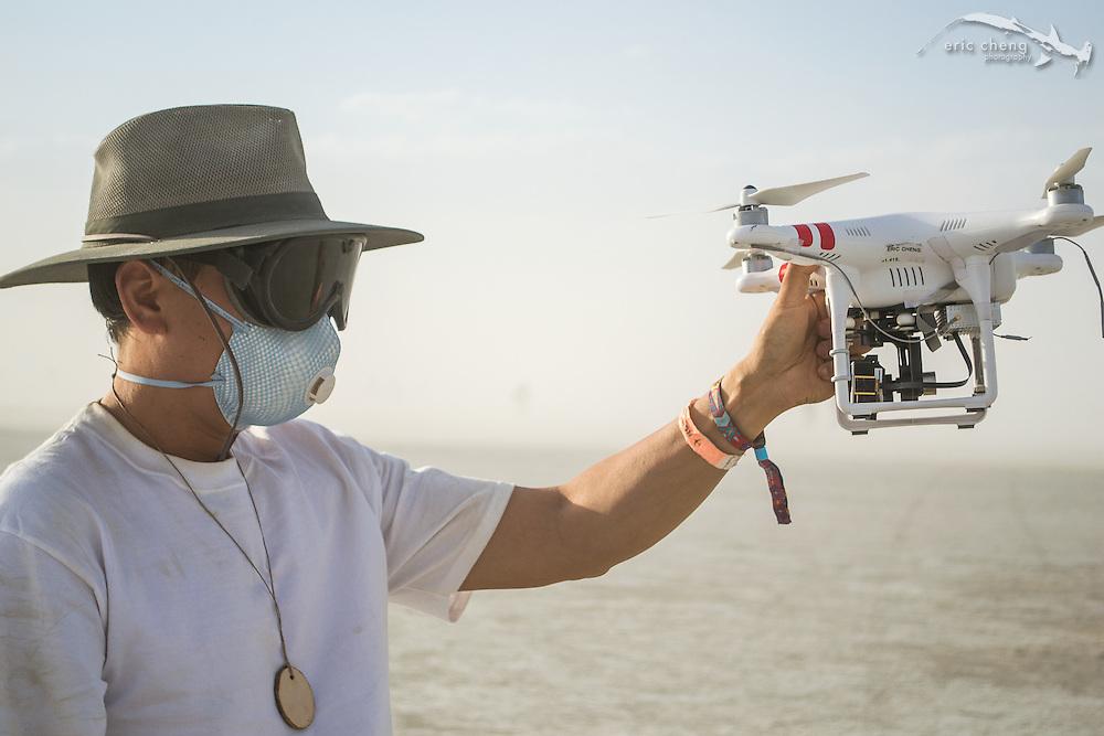 Eric Cheng flies a DJI Phantom 2 out on the playa (photo: Gerard Mattimoe) Burning Man 2014.