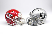 Detailed view of Kansas City Chiefs and Oakland Raiders helmets.