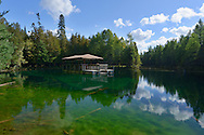 Kitch-iti-kipi is Michigan's largest freshwater spring. Over 10,000 gallons a minute gush from fissures in the underlying limestone. The flow continues throughout the year at a constant 45 degree Fahrenheit.<br />