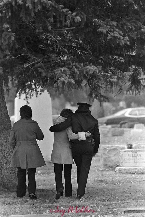 Funeral for fallen Denver Police officer Donald DeBruno., December, 1975. He was 30. More than 1500 people, mostly law enforcement officers. attended the Mass of Christian Burial at St. Jude Church in Lakewood, CO.<br />