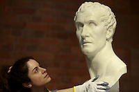 Adeline member of Scottish Gallery of Scotland press office holding sculpture Antonio Canova (1757-1822). Scottish Gallery of Scotland display a new exhibition called Head to Head. Portrait Sculpture  from 6th June 2014 to 10 January 2016.<br /> <br /> Pic by Pako Mera
