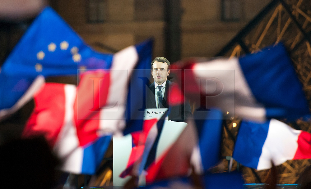 © London News Pictures. 07/05/2017. Paris, France. Emmanuel Macron delivers a victory speech outside The Louvre in Paris after being elected president of France, beating his opponent Marine Le Penn of the Front National 66%-33%. Macron will appoint a prime minster and cabinet to to his newly formed party En Marche! in the coming days. Photo credit: Guilhem Baker/LNP