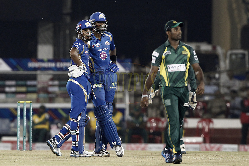 Kieron Pollard talk with Lendl Simmons of the Mumbai Indians during the qualifier 4 match of the Oppo Champions League Twenty20 between the Mumbai Indians and the Southern Express held at the Chhattisgarh International Cricket Stadium, Raipur, India on the 14th September 2014<br /> <br /> Photo by:  Deepak Malik / Sportzpics/ CLT20<br /> <br /> <br /> Image use is subject to the terms and conditions as laid out by the BCCI/ CLT20.  The terms and conditions can be downloaded here:<br /> <br /> http://sportzpics.photoshelter.com/gallery/CLT20-Image-Terms-and-Conditions-2014/G0000IfNJn535VPU/C0000QhhKadWcjYs