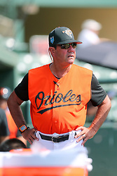 July 17, 2018 - Sarasota, FL, U.S. - Sarasota, FL - JUL 17: Orioles Manager Carlos Tosca (12) watches the action on the field during the Gulf Coast League (GCL) game between the GCL Twins and the GCL Orioles on July 17, 2018, at Ed Smith Stadium in Sarasota, FL. (Photo by Cliff Welch/Icon Sportswire) (Credit Image: © Cliff Welch/Icon SMI via ZUMA Press)