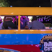 MIAMI BEACH, FLORIDA, NOVEMBER 4, 2016<br /> A party bus full of revelers drives on Miami Beach's popular Ocean Drive on a Friday night. Recent incidents of violence and crime are pushing the city of Miami Beach to try to alter the appeal of the area.<br /> (Photo by Angel Valentin/Freelance)