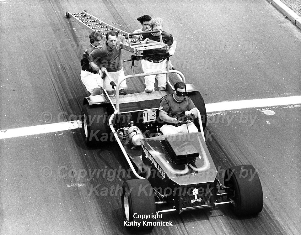 The East Meadow Fire Department Meadowlarks Racing Team in action in June of 1982.