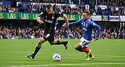 Kyle Bennett and Lee Collins chase down the free ball during the Sky Bet League 2 match between Portsmouth and Mansfield Town at Fratton Park, Portsmouth, England on 24 October 2015. Photo by Michael Hulf.