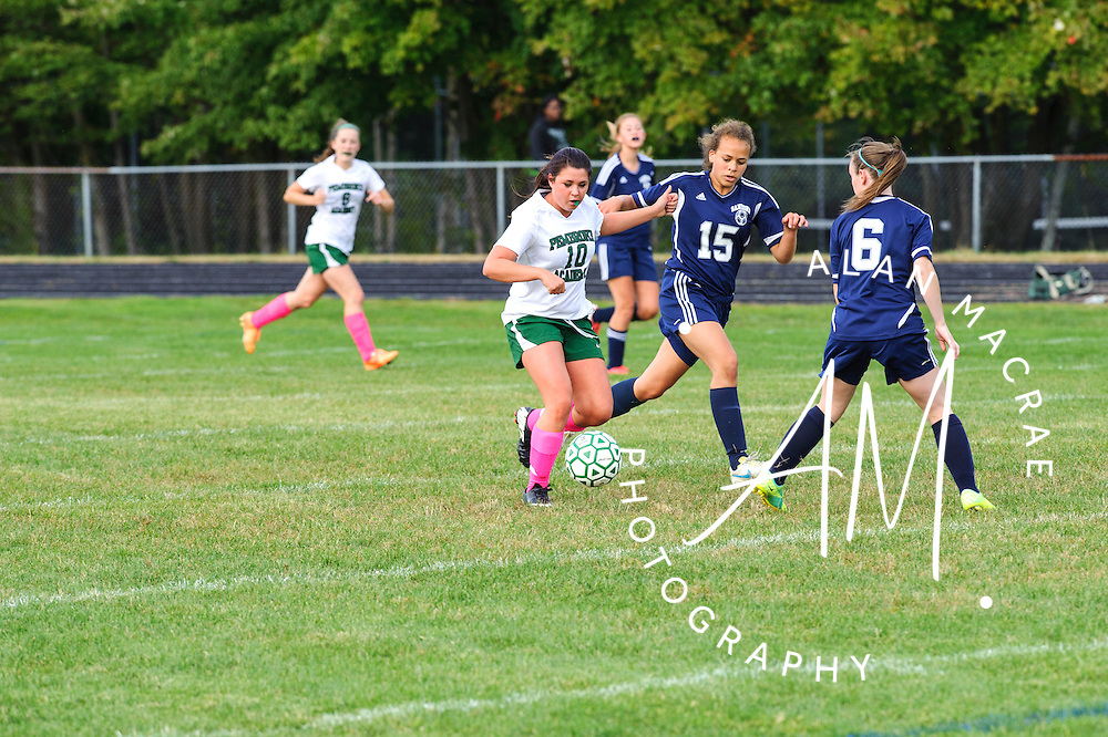 PA junior Celia Sartwell kicks the ball past Sanborn junior Ashlyn Forbes during Thursday's game at Pembroke.  (Alan MacRae/for the Monitor)