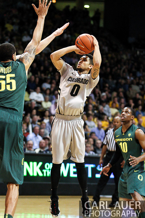 March 3, 2013: Boulder, Colorado - Colorado Buffaloes sophomore guard Askia Booker (0) attempts a jump shot over the Oregon defense in the Colorado Buffaloes game against the University of Oregon Ducks at the Coors Events Center