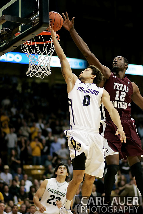 November 27, 2012: Texas Southern Tigers senior center Kyrie Sutton (12) blocks the shot attempt by Colorado Buffaloes sophomore guard Askia Booker (0) in the NCAA Basketball game between the Texas Southern Tigers and the Colorado Buffaloes at the Coors Event Center in Boulder Colorado