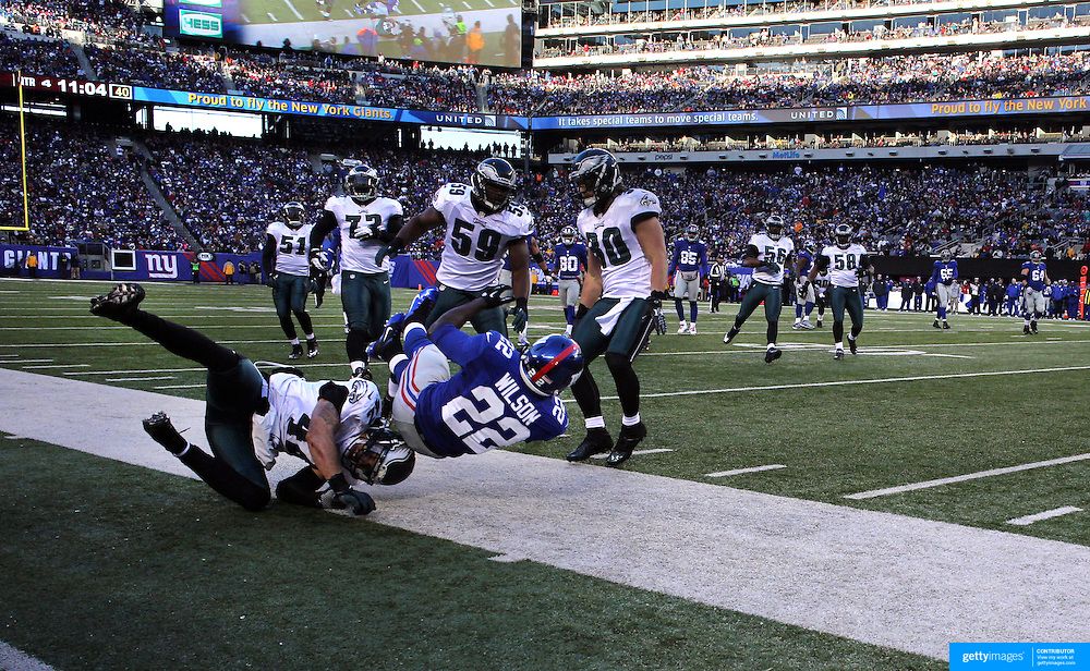 David Wilson, Giants, is tackled during the New York Giants V Philadelphia Eagles NFL American Football match at MetLife Stadium, East Rutherford, NJ, USA. 30th December 2012. Photo Tim Clayton