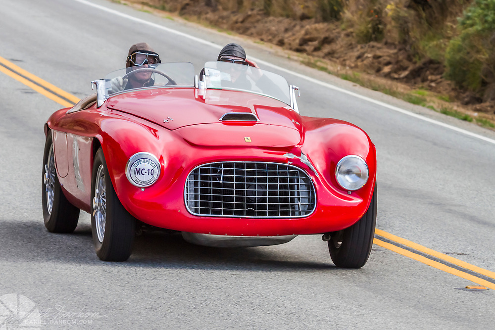 1949 Ferrari 166 MM Touring Barchetta in the Tour d Elegance, along Highway 1 on the Big Sur Coast. Classic and Historic autos participate in the Pebble Beach, Concours d Elegance, take to the highway to tour the Monterey Peninsula and coast.