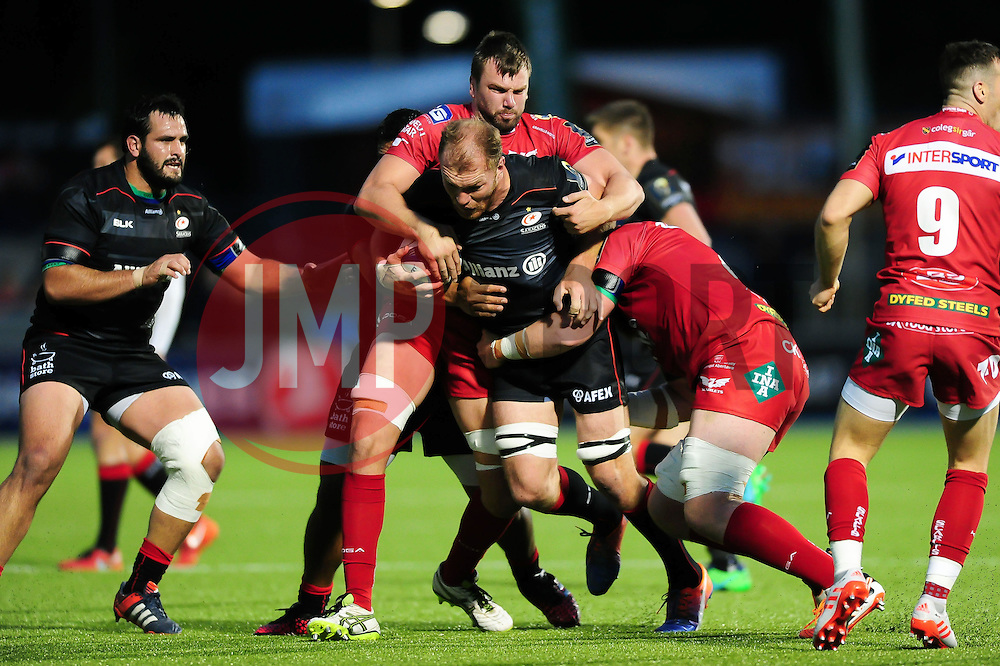 Schalk Burger of Saracens takes on the Scarlets defence - Mandatory byline: Patrick Khachfe/JMP - 07966 386802 - 22/10/2016 - RUGBY UNION - Allianz Park - London, England - Saracens v Scarlets - European Rugby Champions Cup.