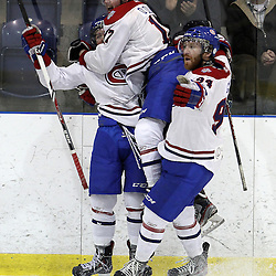KINGSTON,ON-Mar 20 :<br />  Ontario Junior Hockey League, OJHL North East Conference playoff series round two, Kingston Voyageurs vs Trenton Golden Hawks. Kingston Voyageur's Hockey Club celebrates the goal during second period game action.  (Photo by Robert John Boucher / OJHL Images)