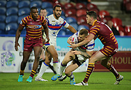 Lee Gaskill of Huddersfield Giants tackles Tom Johnstone of Wakefield Trinity around the head during the Betfred Super League Super 8's match at the John Smiths Stadium, Huddersfield<br /> Picture by Stephen Gaunt/Focus Images Ltd +447904 833202<br /> 31/08/2018