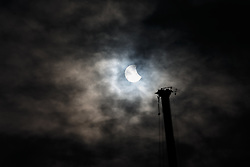The Solar Eclipse is seen alongside a crane working on the new stand development  Bristol Sport's Ashton Gate Stadium, home to Bristol City FC and Bristol Rugby - Photo mandatory by-line: Rogan Thomson/JMP - 07966 386802 - 20/03/2015 - Bristol, England - Ashton Gate Stadium - 2015 Solar Eclipse in the UK.