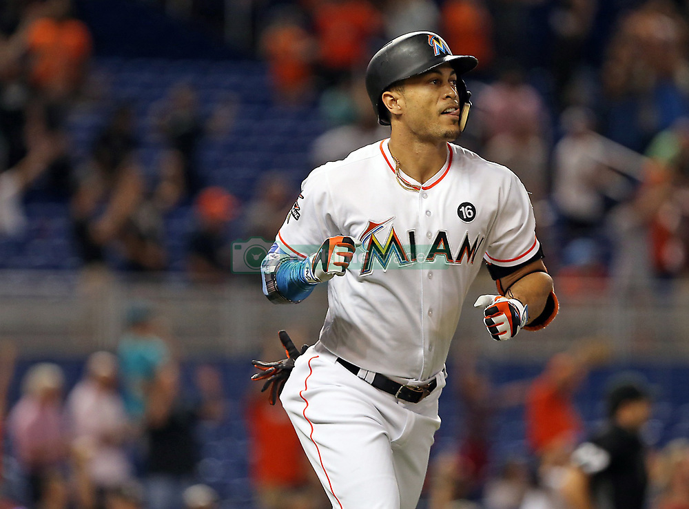August 14, 2017 - Miami, FL, USA - Giancarlo Stanton runs the bases and pumps his fist as he breaks the Marlins' season homerun record hitting his 43rd dinger of the season as the Miami Marlins host the San Francisco Giants on Monday, Aug. 14, 2017 in Miami. (Credit Image: © Patrick Farrell/TNS via ZUMA Wire)