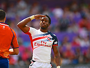 USA player Carlin Isles salutes a US section of the crowd after scoring a try in the game USA vs Scotland during the Cathay Pacific/HSBC Hong Kong Sevens festival at the Hong Kong Stadium, So Kon Po, Hong Kong. on 8/04/2018. Picture by Ian  Muir.