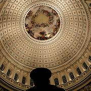 A Capitol Hill Police Officers watches as mourners walk past the casket of President Reagan in the Rotunda of the US Capitol Wednesday, June 9, 2004.  The former president will lie-in-state there until Friday morning...Photo by Khue Bui