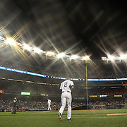 Derek Jeter, New York Yankees, playing in his final season, heads out from the dug out to field at shortstop  during the New York Yankees V New York Mets, Subway Series game at Yankee Stadium, The Bronx, New York. 12th May 2014. Photo Tim Clayton<br /> (Note to editors: A special effects starburst filter was used in the creation of this image)