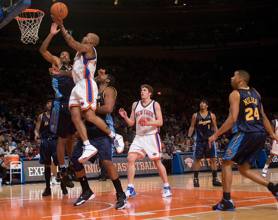 Stephon Marbury of the New York Knicks goes to the hoop against the Denver Nuggets at Madison Square Garden, New York on Saturday  16 December 2006. (Andrew Gombert for The New York TImes)<br />