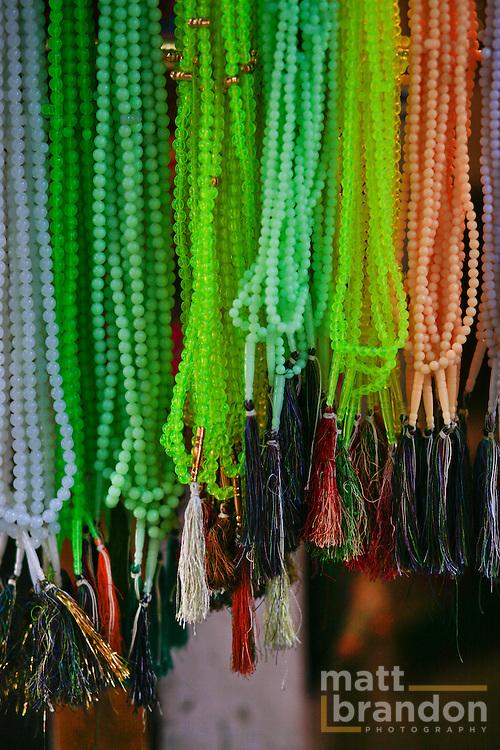 Prayer beads hang at a shop in Nizamuddin.