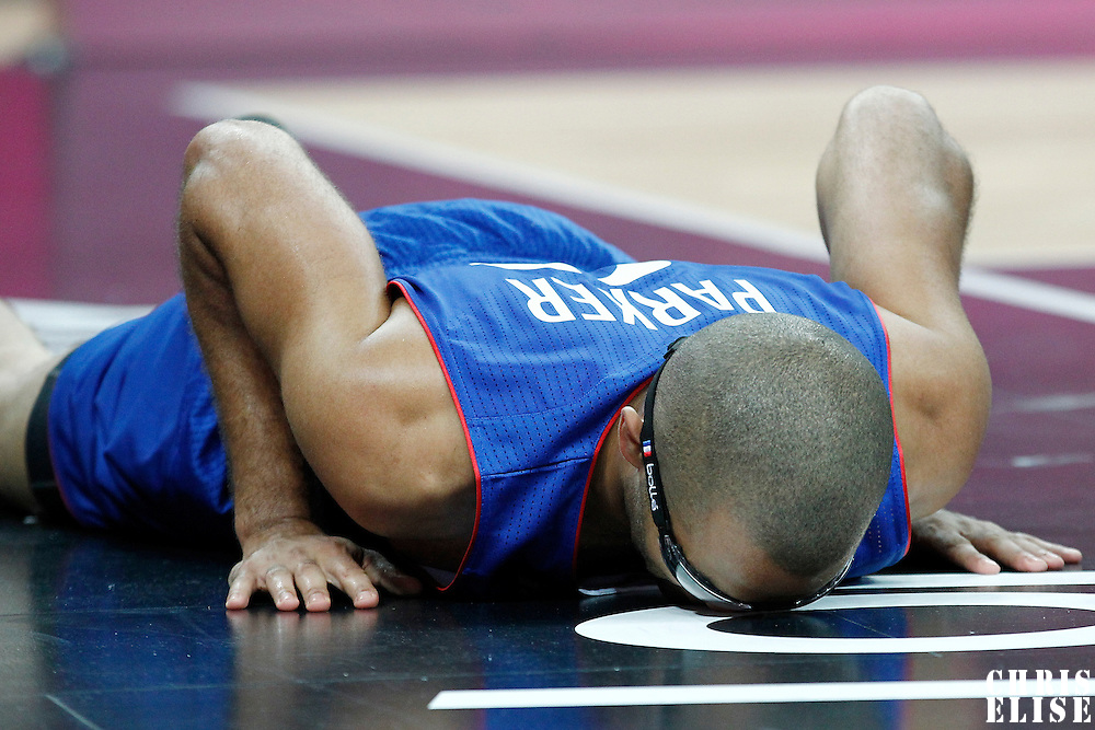 04 August 2012: France Tony Parker is seen down on the floor during 73-69 Team France victory over Team Tunisia, during the men's basketball preliminary, at the Basketball Arena, in London, Great Britain.